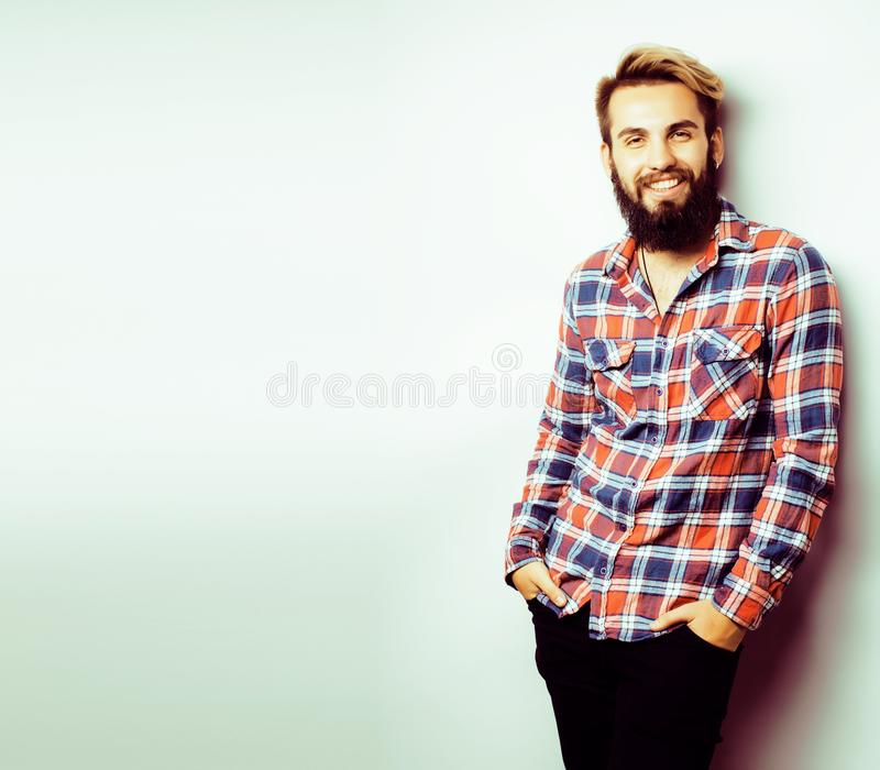 Portrait of young bearded hipster guy smiling on white background stock image