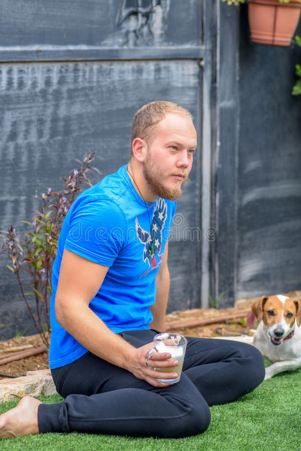 Portrait Of A Young Bearded Man and Dog Outdoor. stock images