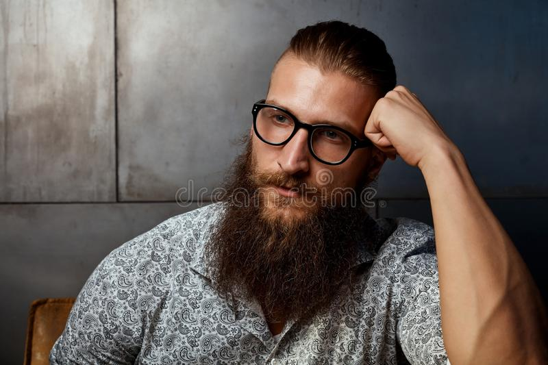 Portrait of young smart bearded man in glasses royalty free stock photos