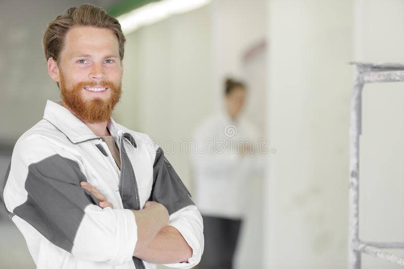Portrait young bearded painter and decorator royalty free stock images