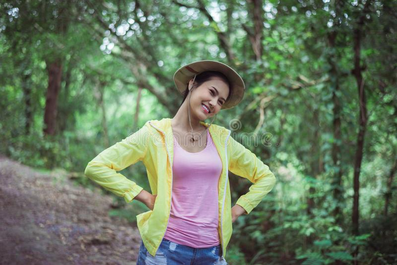 Portrait of young beautiful asian woman happy and smiling while lstanding at nature,Travel at outdoor stock photos