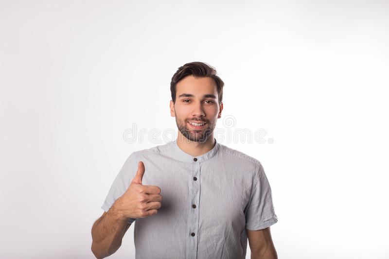 Portrait of a young beautiful bearded caucasian man business worker shows hand sign well and looking in camera stock image