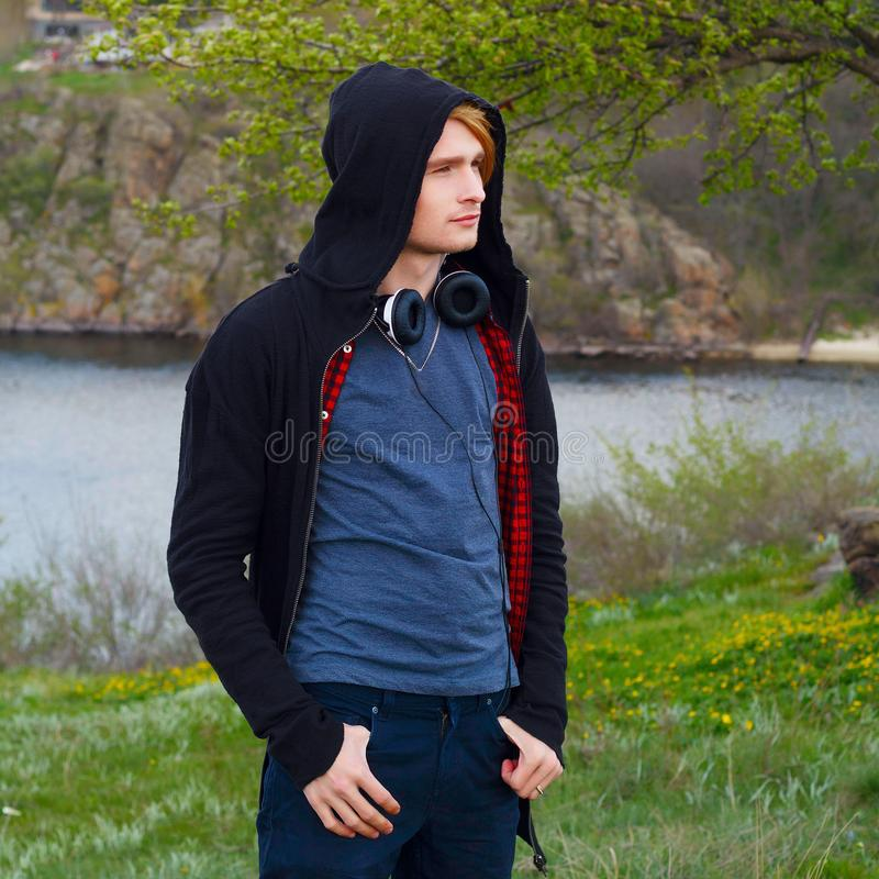 Portrait of young beautiful blond hipster man with headphones st stock photos