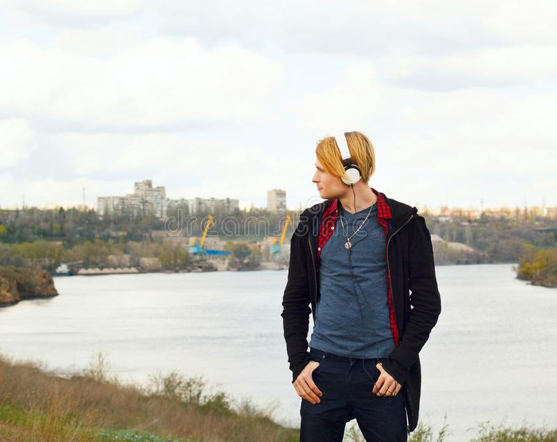 Portrait of young beautiful blond hipster man with headphones st royalty free stock photos