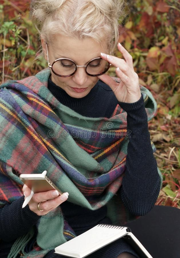 Portrait of a young beautiful blond woman with glasses stock photography