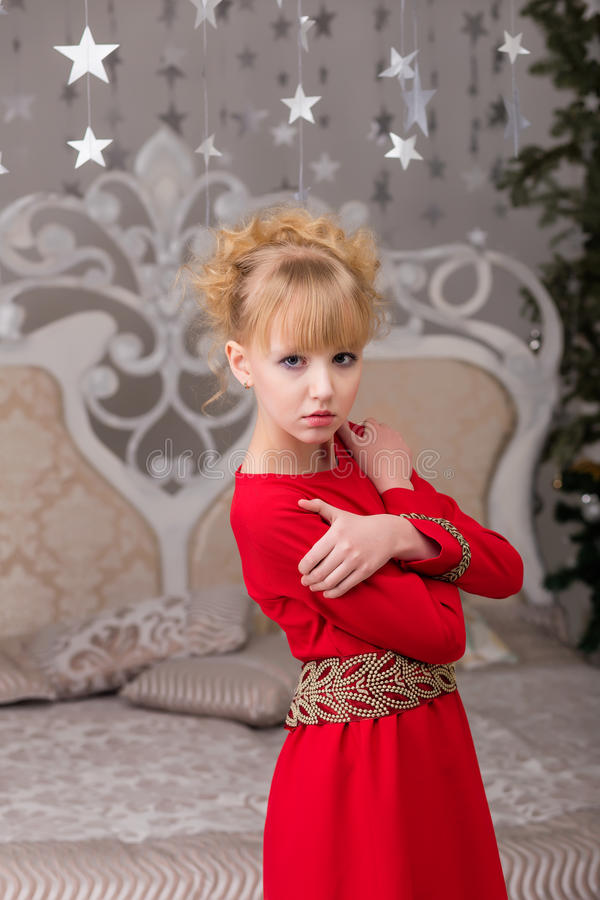 Download Portrait Of A Young Beautiful Blonde In A Red Dress At The Chris Stock Photo - Image: 83718639