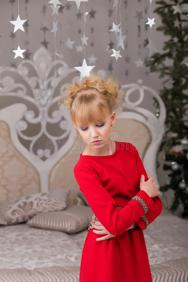 Download Portrait Of A Young Beautiful Blonde In A Red Dress At The Chris Stock Photo - Image: 83718734