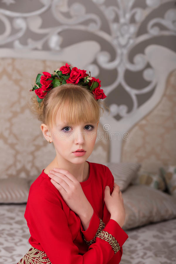 Download Portrait Of A Young Beautiful Blonde In A Red Dress At The Chris Stock Image - Image: 83719313