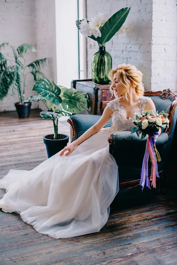 Portrait of a young beautiful bride in the interior royalty free stock photography