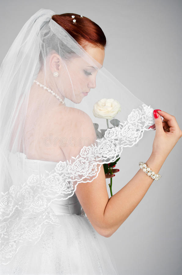 Portrait of young beautiful bride with rose royalty free stock photo