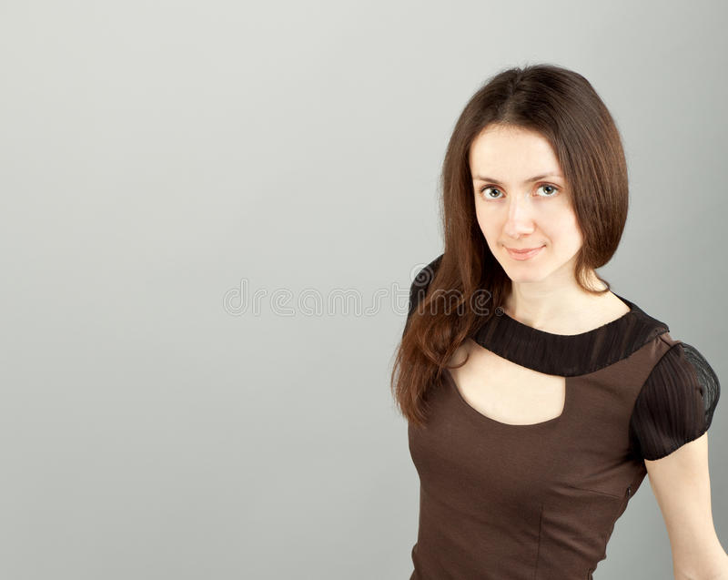 Portrait of a young beautiful brunette girl stock image