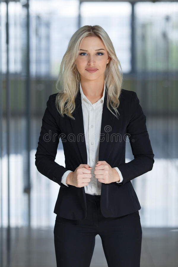 Portrait of a young beautiful businesswoman, Bright blurred background. royalty free stock photos