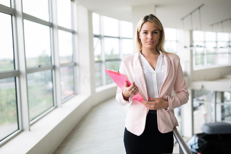 Portrait of young busineswoman standing in office lobby. Portrait of young beautiful busineswoman standing in office lobby stock images