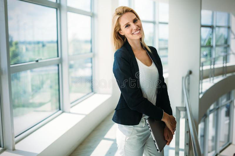 Portrait of young busineswoman standing in office lobby. Portrait of young beautiful busineswoman standing in office lobby royalty free stock photo