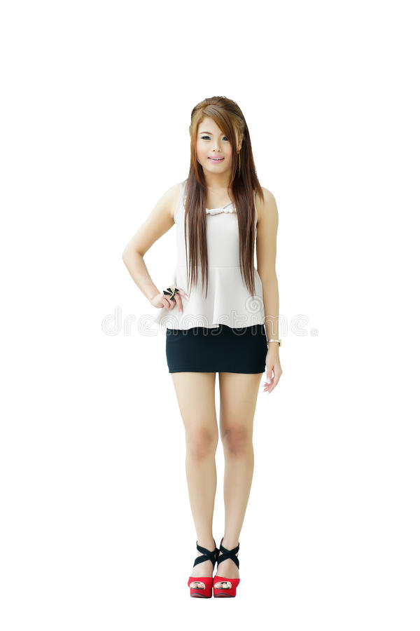 Portrait young beautiful casual woman standing isolated against royalty free stock image
