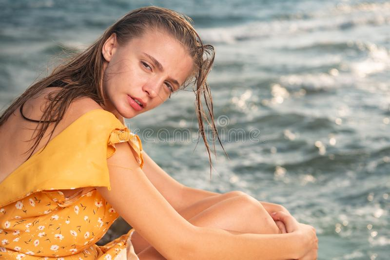 Portrait of a Young beautiful caucasian blond at the beach royalty free stock photo