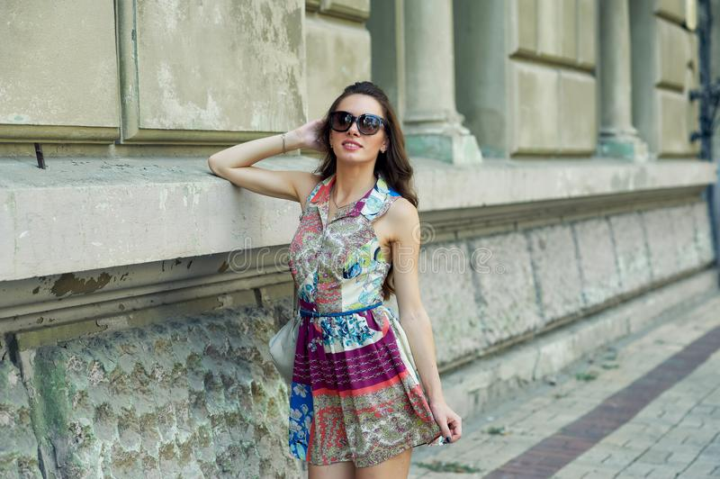 Portrait of a young beautiful fashionable woman on the streets of the city royalty free stock image