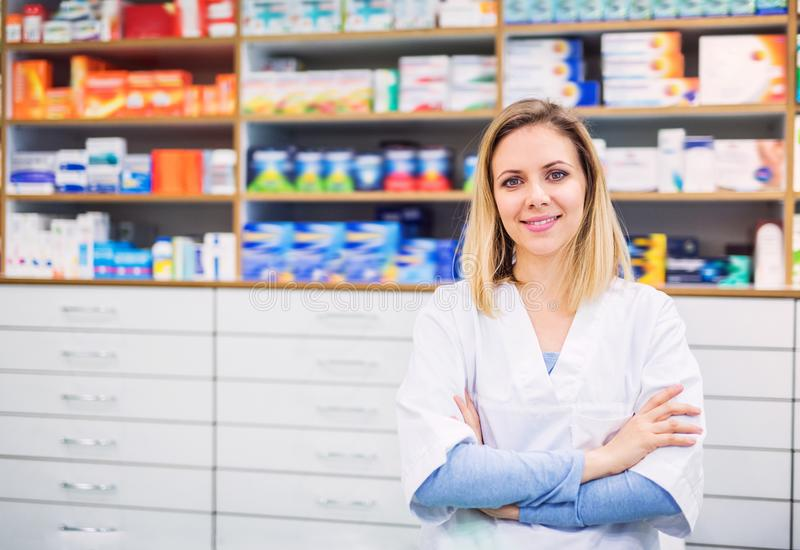 Portrait of a young friendly female pharmacist. royalty free stock photos