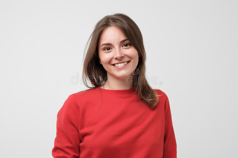 Portrait of young beautiful gcaucasian woman in red t-shirt cheerfuly smiling looking at camera. royalty free stock images
