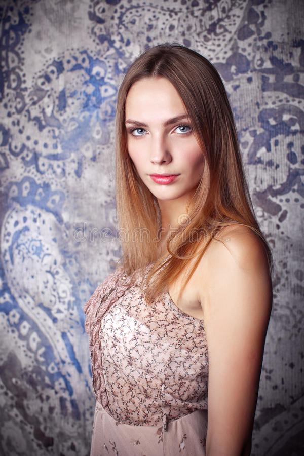 Portrait of young beautiful girl with brown hair. Make up. Vogue Style stock photo