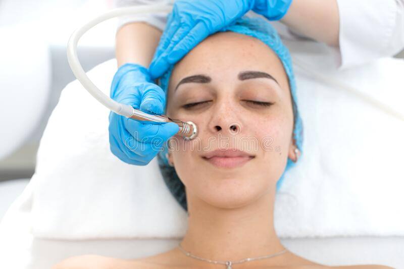 Portrait of a young beautiful girl face vacuum therapy procedure. Facial care and rejuvenation. Increase epidermal tone.  royalty free stock photos