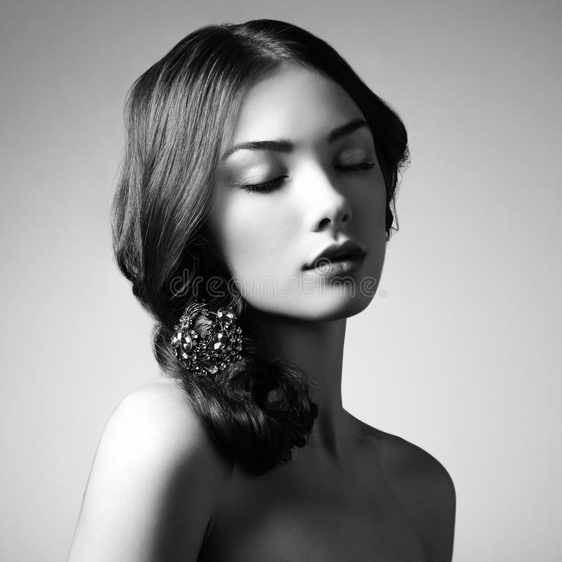 Portrait of young beautiful girl. Fashion photo. Girl with a vintage brooch in her hair royalty free stock images