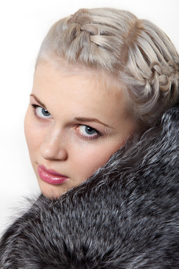 Portrait young beautiful girl in fur coat stock photo