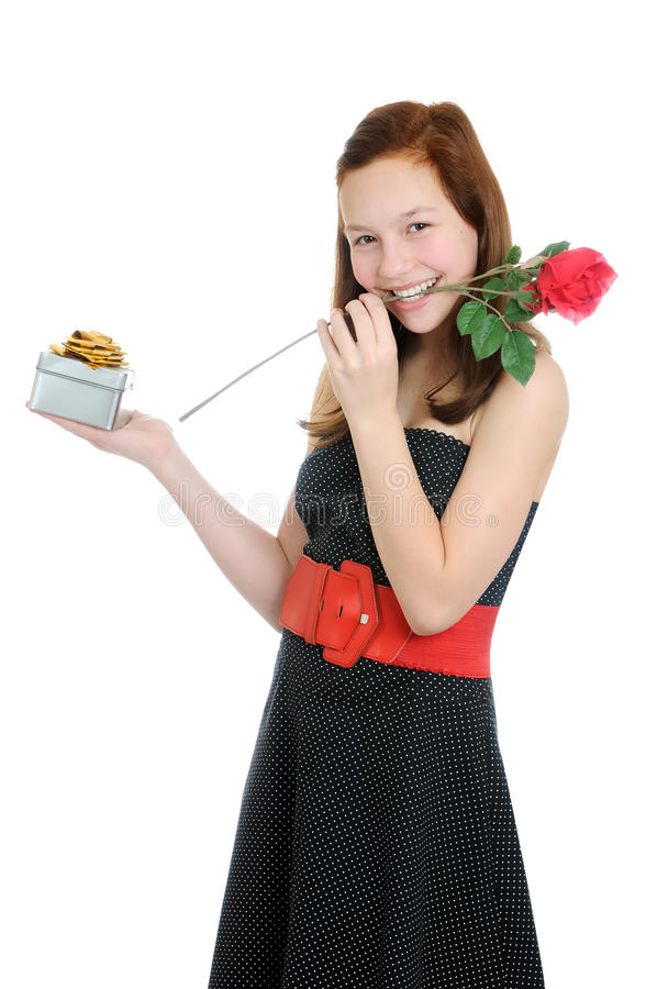 Portrait of a young and beautiful girl with gift and rose isolated on the white background