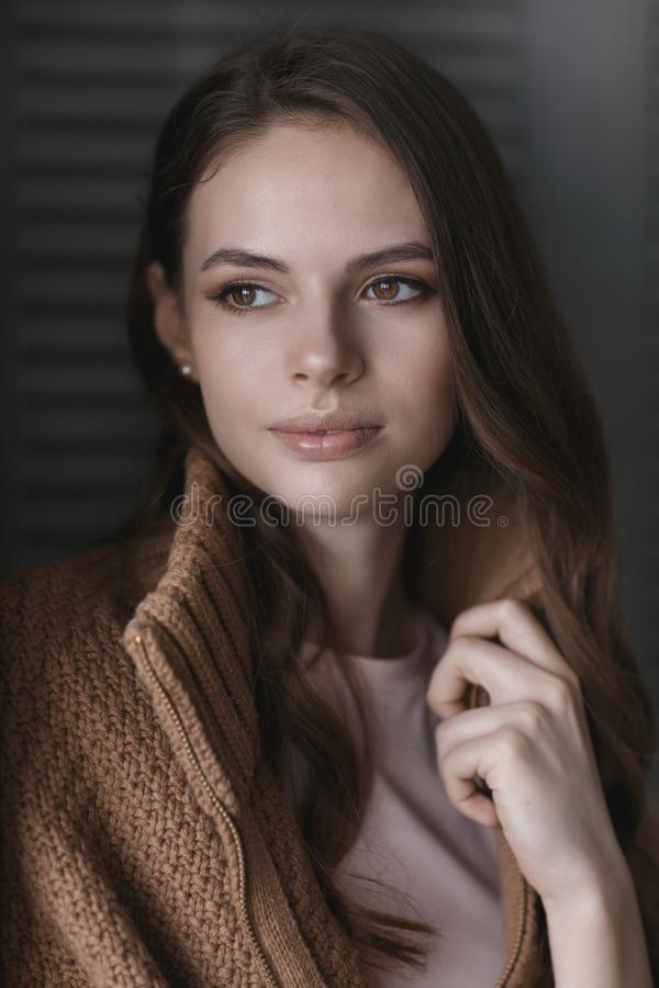 Portrait of a young beautiful girl near the wall stock images