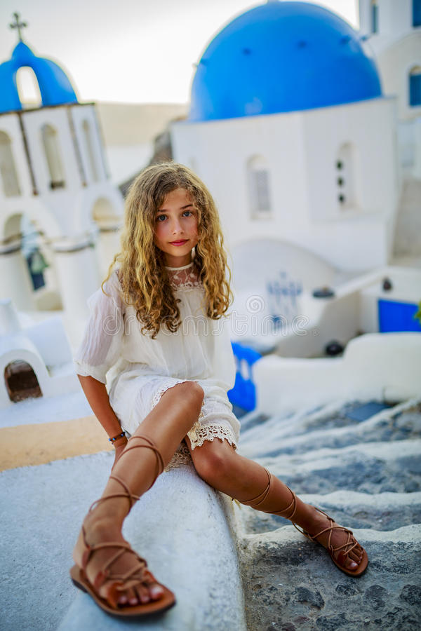 Portrait of young and beautiful girl in Oia. stock image