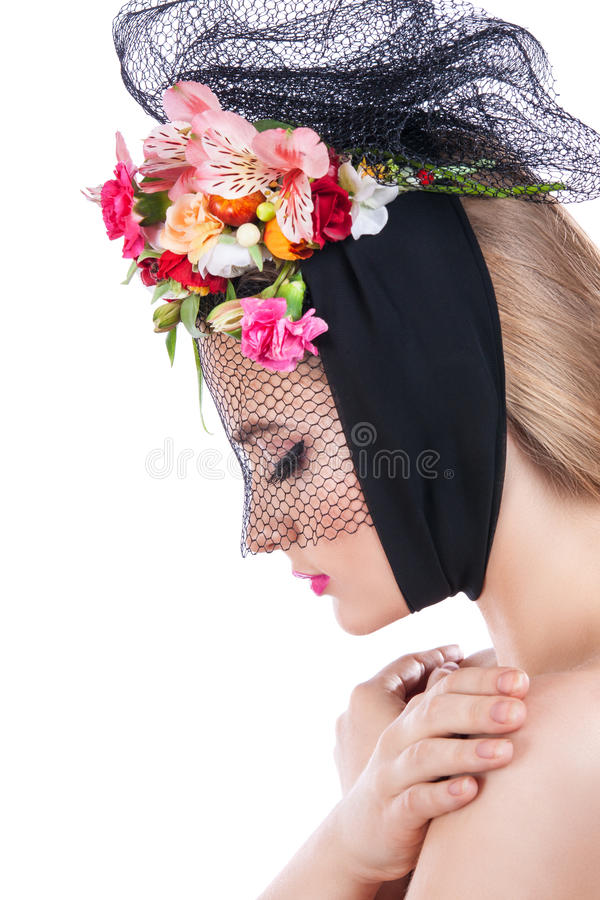 Portrait of a young beautiful girl with a veil on her face. stock photography