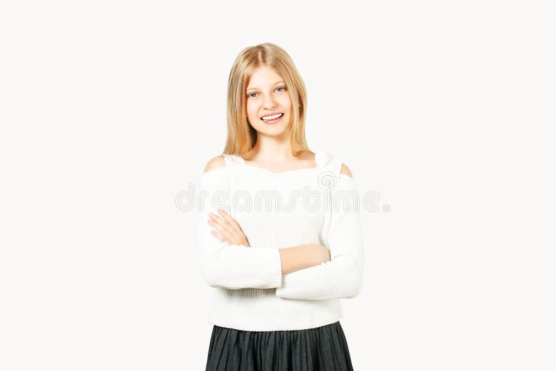 Young beautiful teenager model girl posing over white isolated background showing emotional facial expressions. stock images