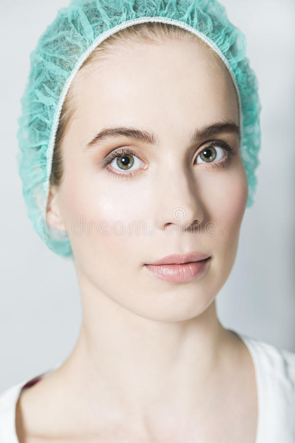 Portrait of young beautiful nurse or patient in medical cap royalty free stock images