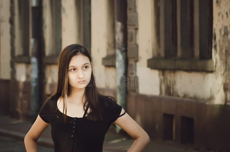 Portrait of young beautiful pretty woman hair posing in city. Retro style royalty free stock images