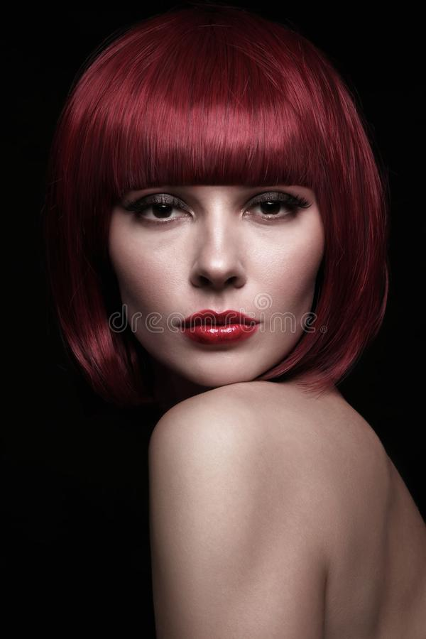 Portrait of young beautiful redhead woman with stylish bob stock photo