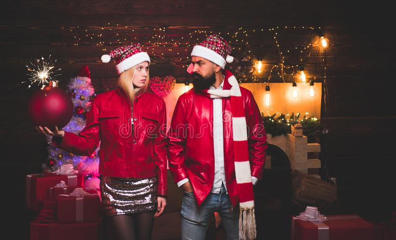 Portrait of a young beautiful smiling couple in home Christmas mood. Love. Positive human emotions facial expressions. Christmas bomb. Creative boom stock images