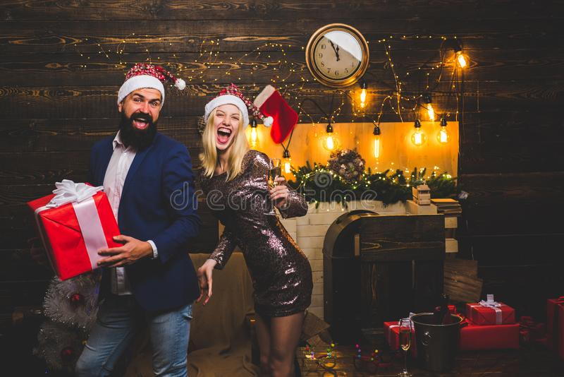 Portrait of a young beautiful smiling couple in home Christmas mood. Love. Positive human emotions facial expressions royalty free stock photo
