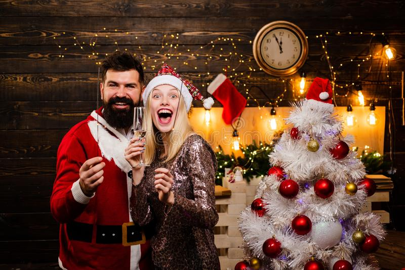 Portrait of a young beautiful smiling couple in home Christmas mood. Make funny face. Couple in love. Drunk Girls royalty free stock photography