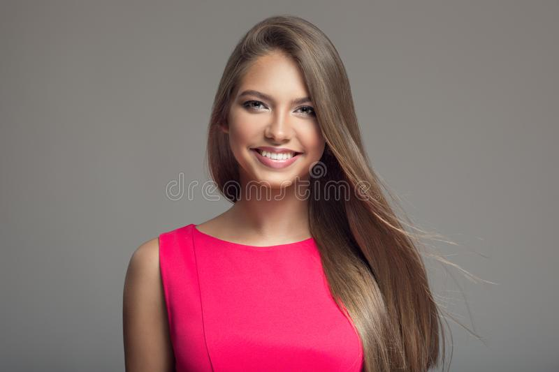 Portrait of young beautiful smiling happy woman. Long hair. stock photography