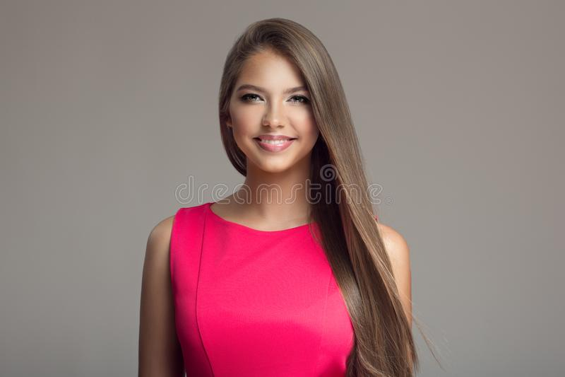 young beautiful smiling happy woman. Long hair. stock photo