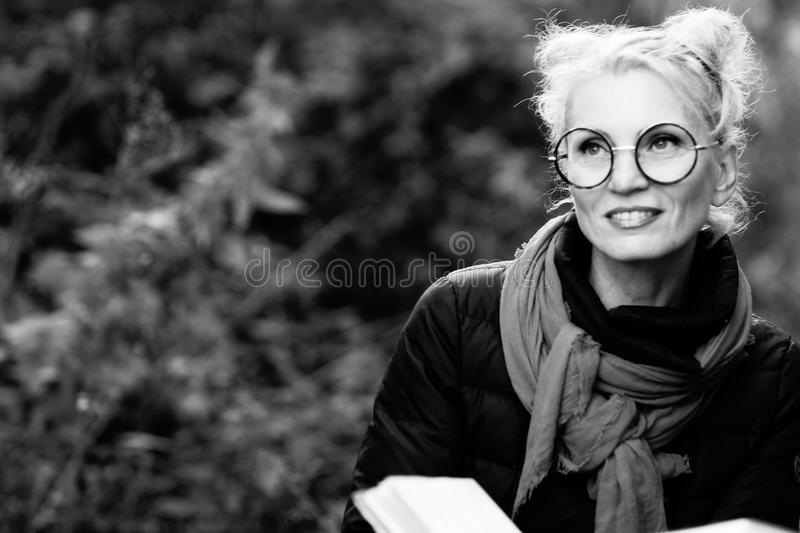 Portrait of a young beautiful smiling woman blond royalty free stock image