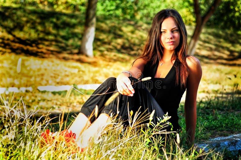 Portrait of young beautiful smiling woman outdoors, enjoying stock image