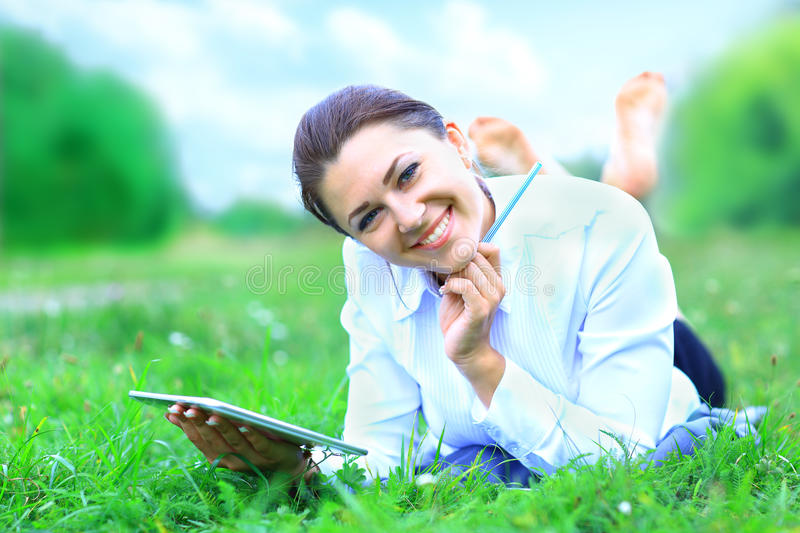 Portrait of young beautiful smiling woman with tablet pc stock image