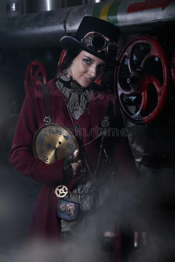 Portrait of a young steampunk woman with a clock face royalty free stock images
