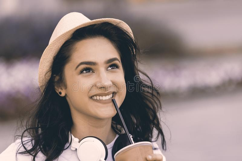 Portrait of young beautiful teenage girl with hat and headphones royalty free stock photography