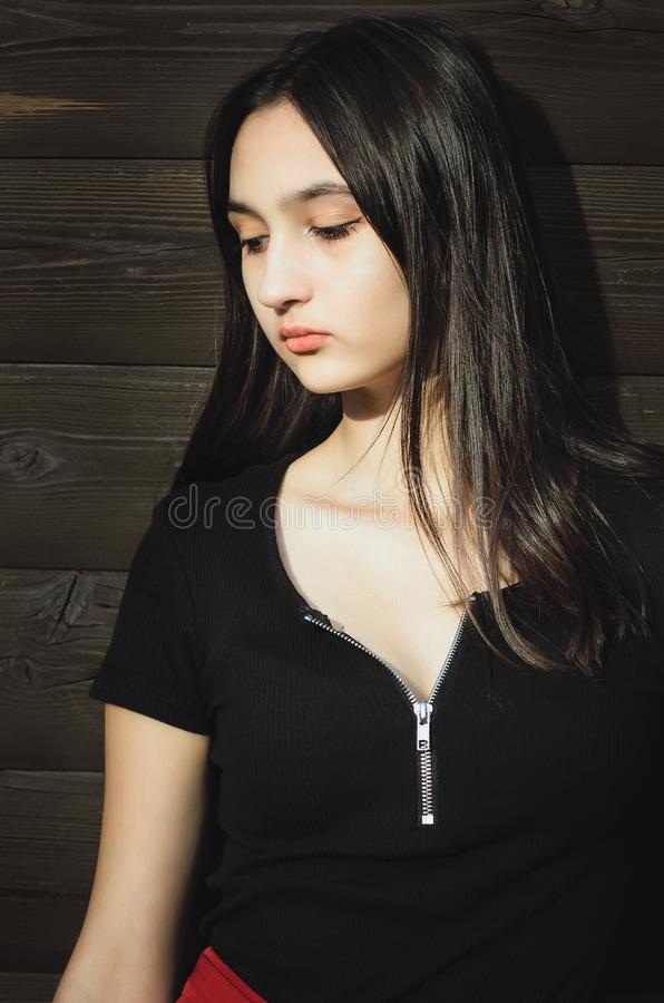 Portrait of a young beautiful teenager girl with long hair. Vertical photograph stock photos