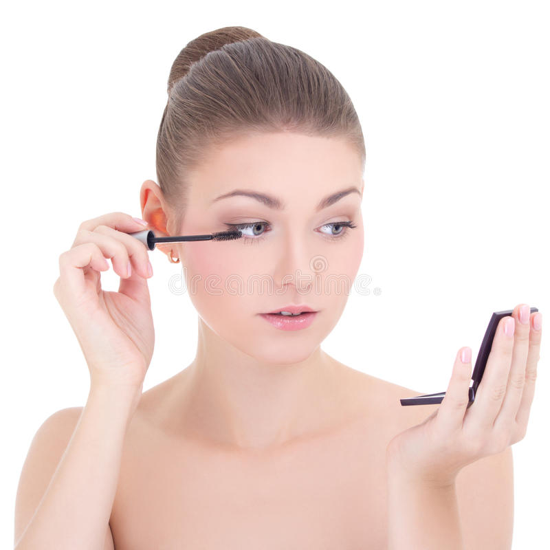 portrait of young beautiful woman applying mascara on her eyelashes isolated on white royalty free stock photo