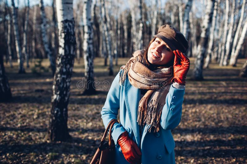 Portrait of young beautiful woman in autumn blye coat. Fashion photo stock image