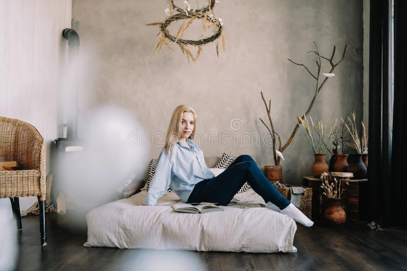 Portrait of a young beautiful woman in bed in the morning at home. Blonde girl in scandinavian interior. Good morning. Lifestyle. Portrait of a young beautiful royalty free stock photos