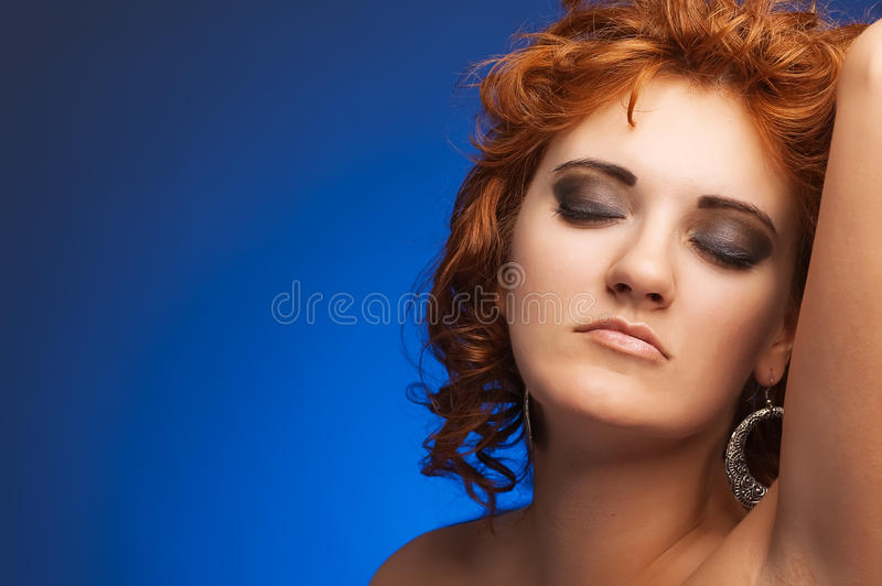 Download Portrait Of Young Beautiful Woman On Blue Stock Photo - Image: 21083826